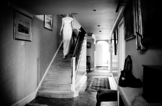 Venetia descending the stairs in her bespoke Emma Victoria Payne wedding dress
