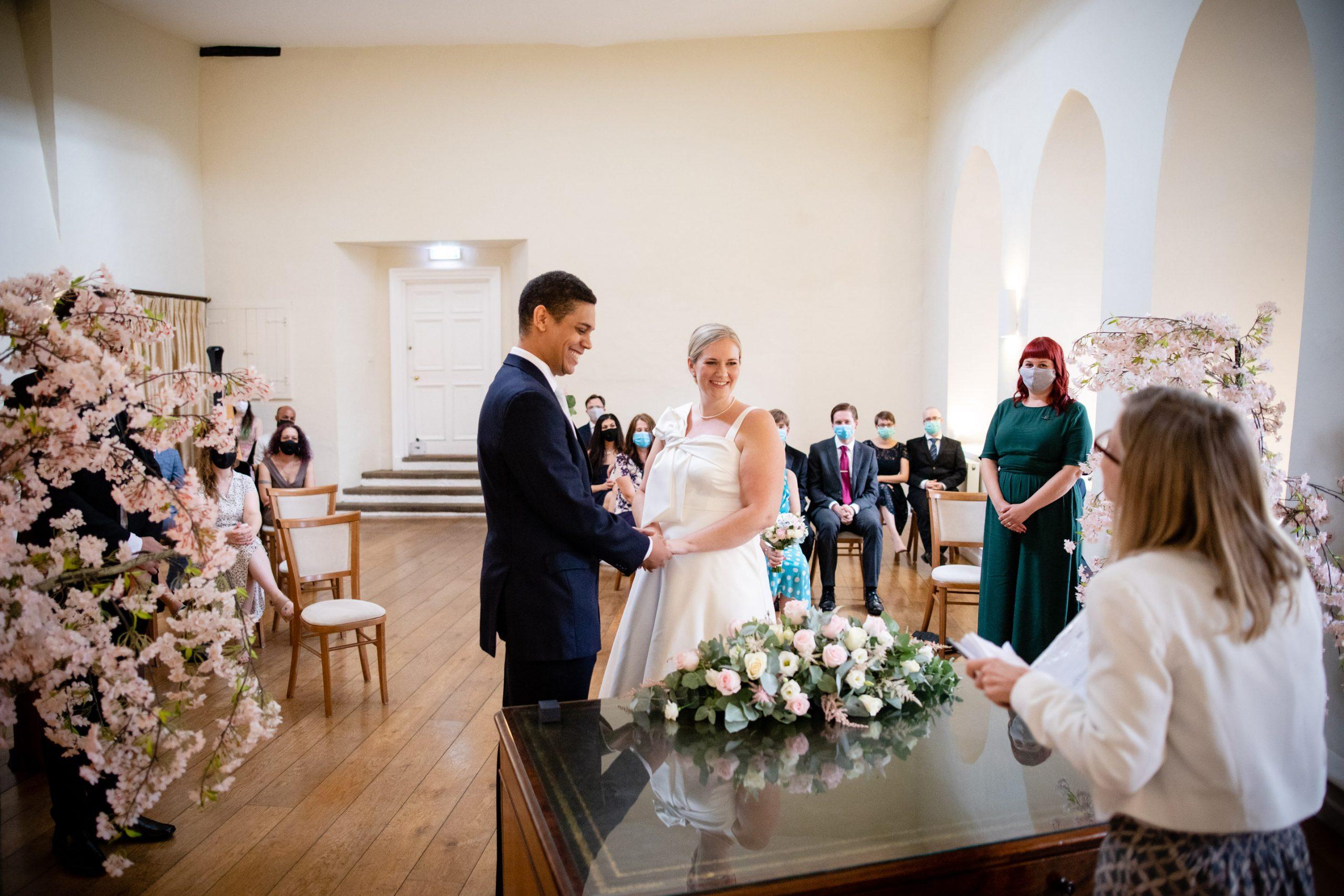 Catherine & Jason's COVID wedding at Farnham Castle taking place in the Lantern Hall.
